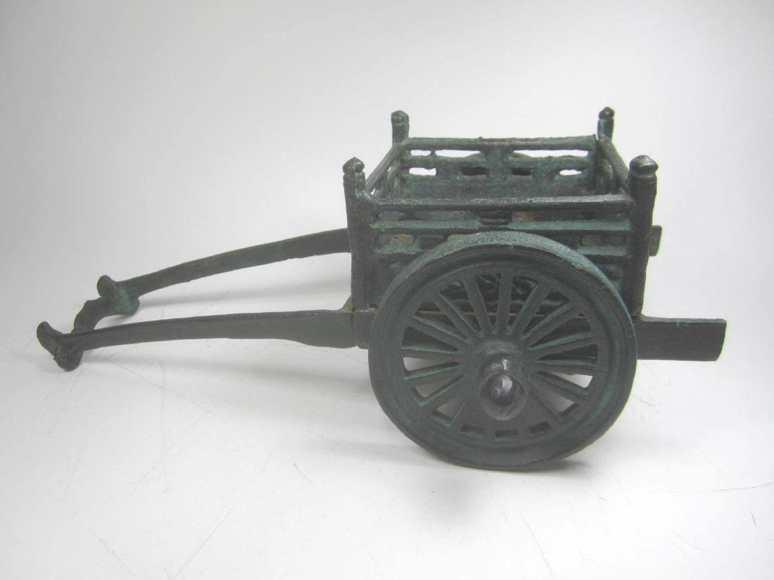 AN OLD CHINESE METAL CARRIAGE MODEL