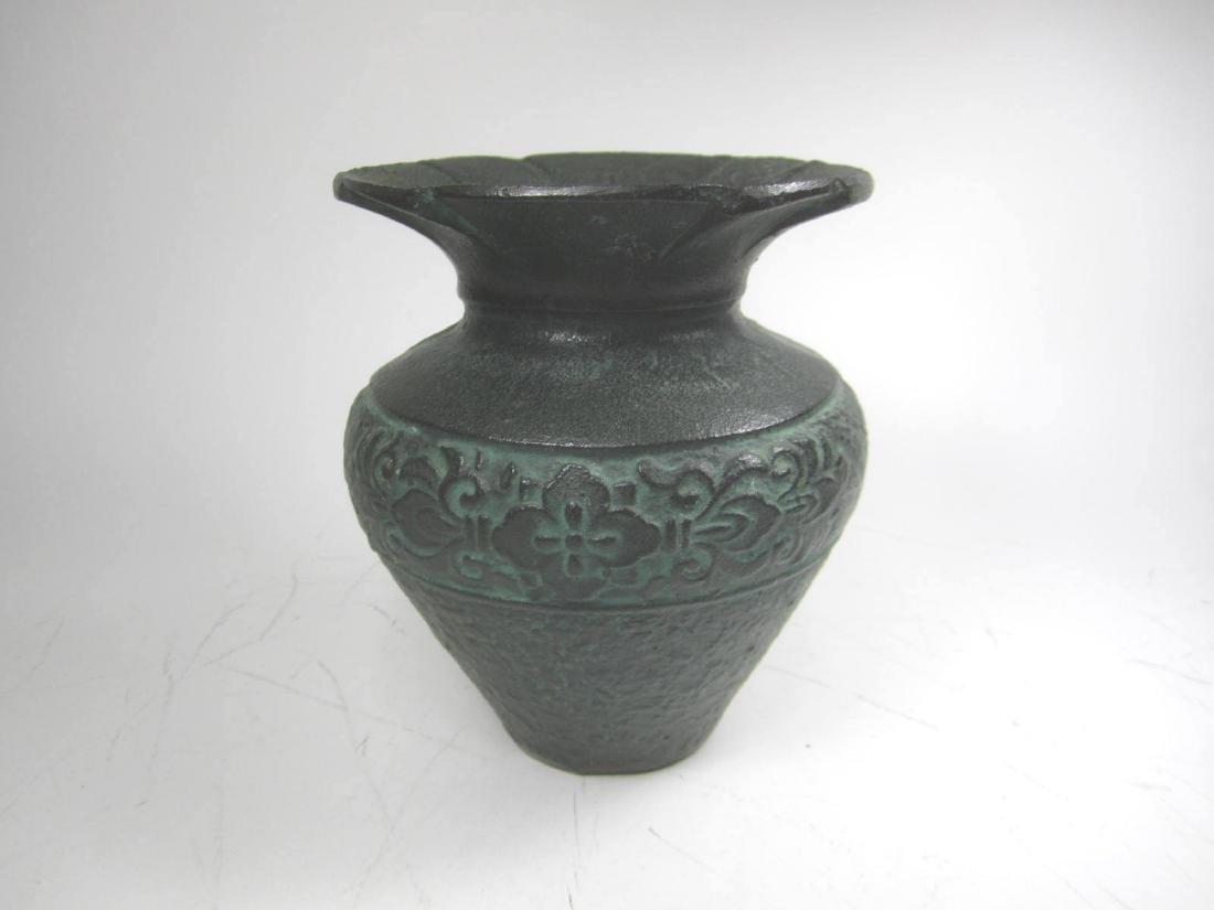 AN OLD CHINESE METAL VASE