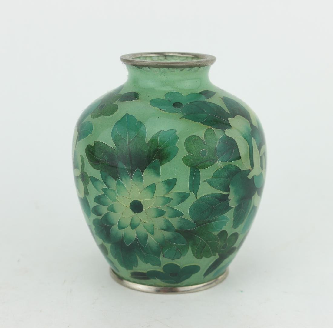 A GREEN GLASS ART JAR