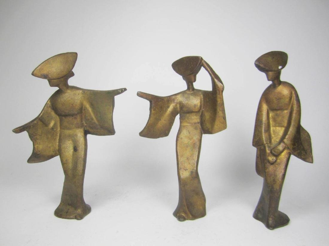THREE GILT BRASS DANCE FIGURINES