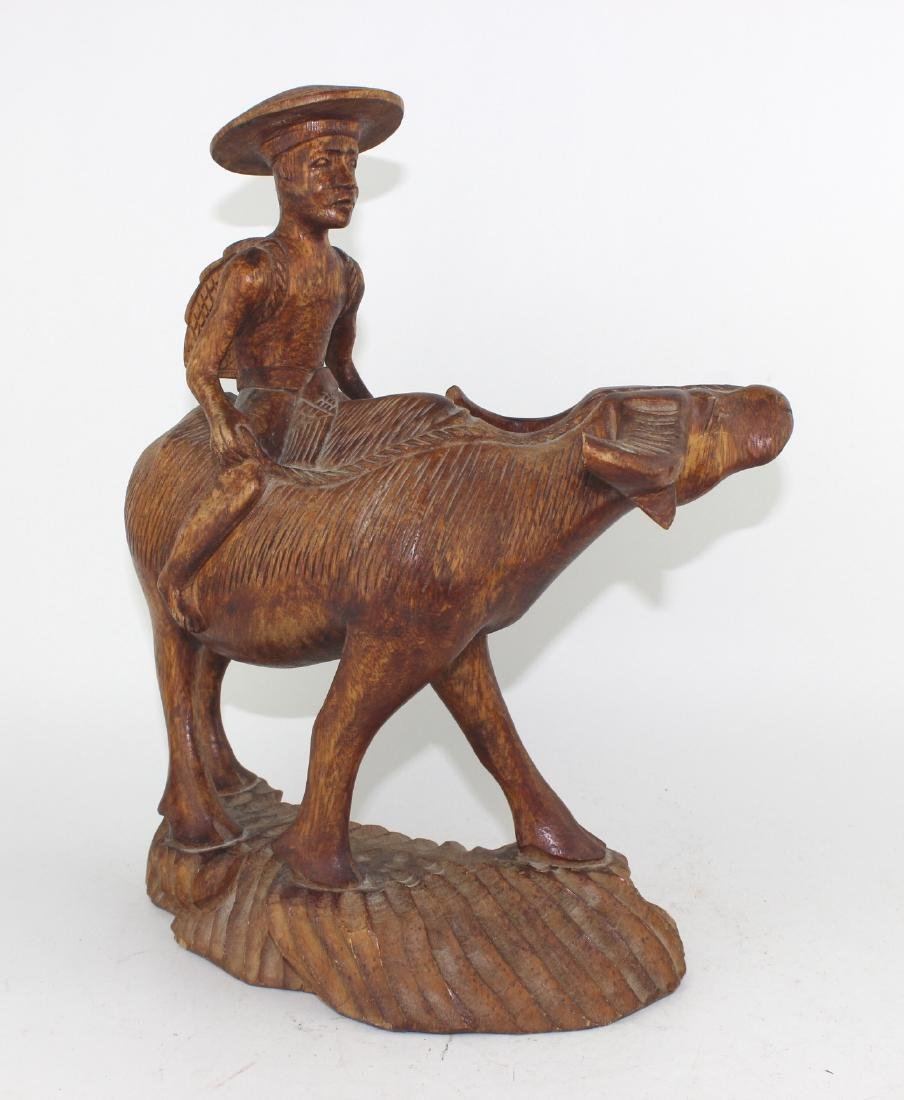 CHINESE CARVED BOY SITTING ON BUFFALO