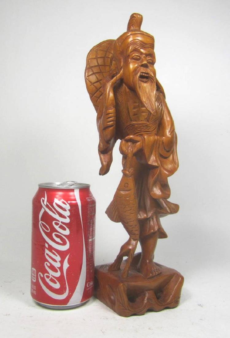 CHINESE CARVED BOXWOOD FISHMAN. - 10