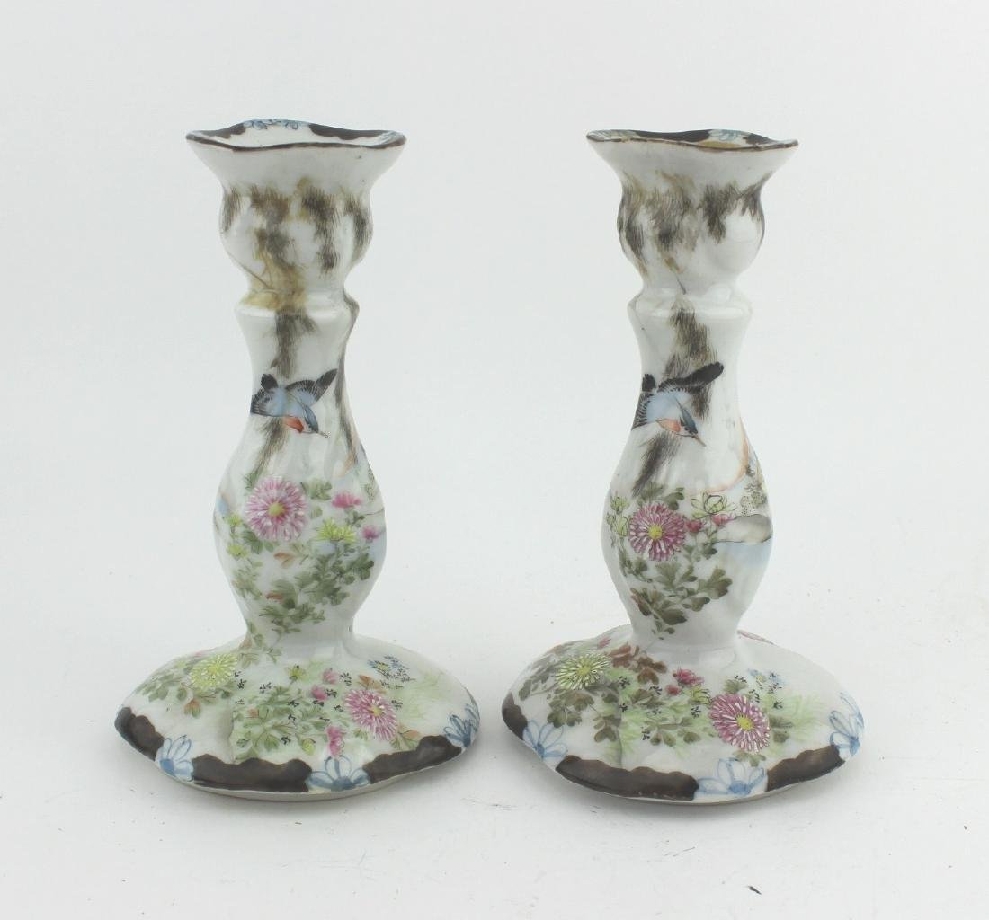 PAIR OF FAMILLE ROSE CANDLE HOLDERS
