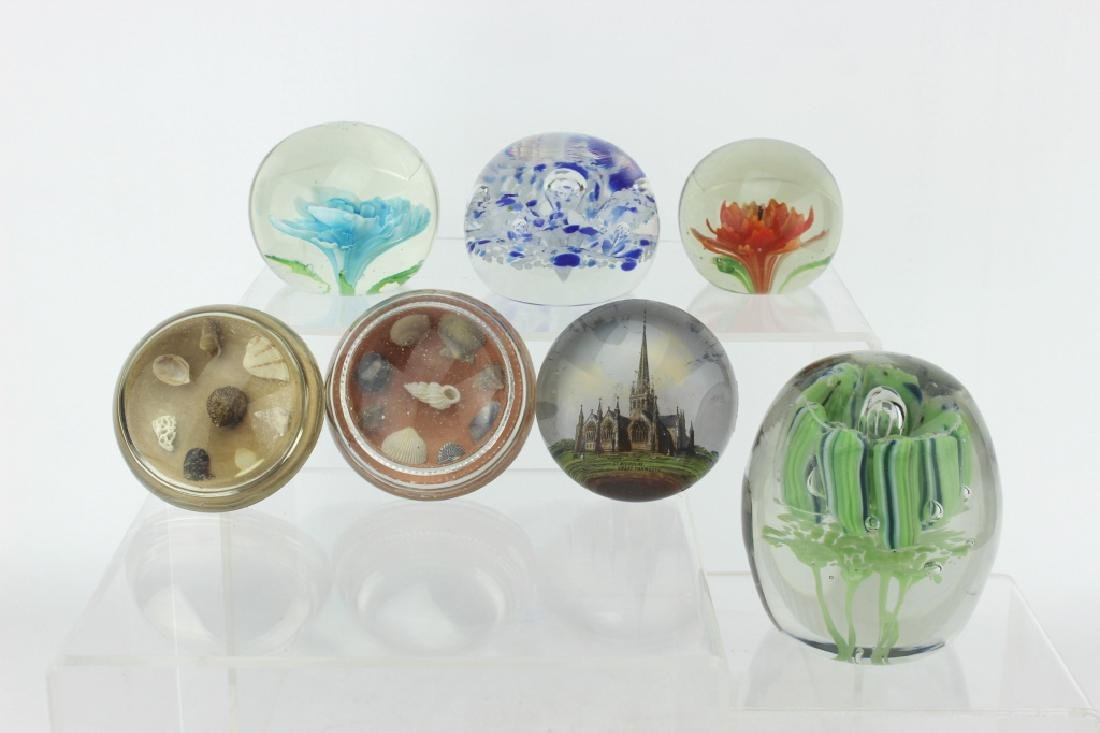 SEVEN ASSORTED GLASS PAPERWEIGHTS