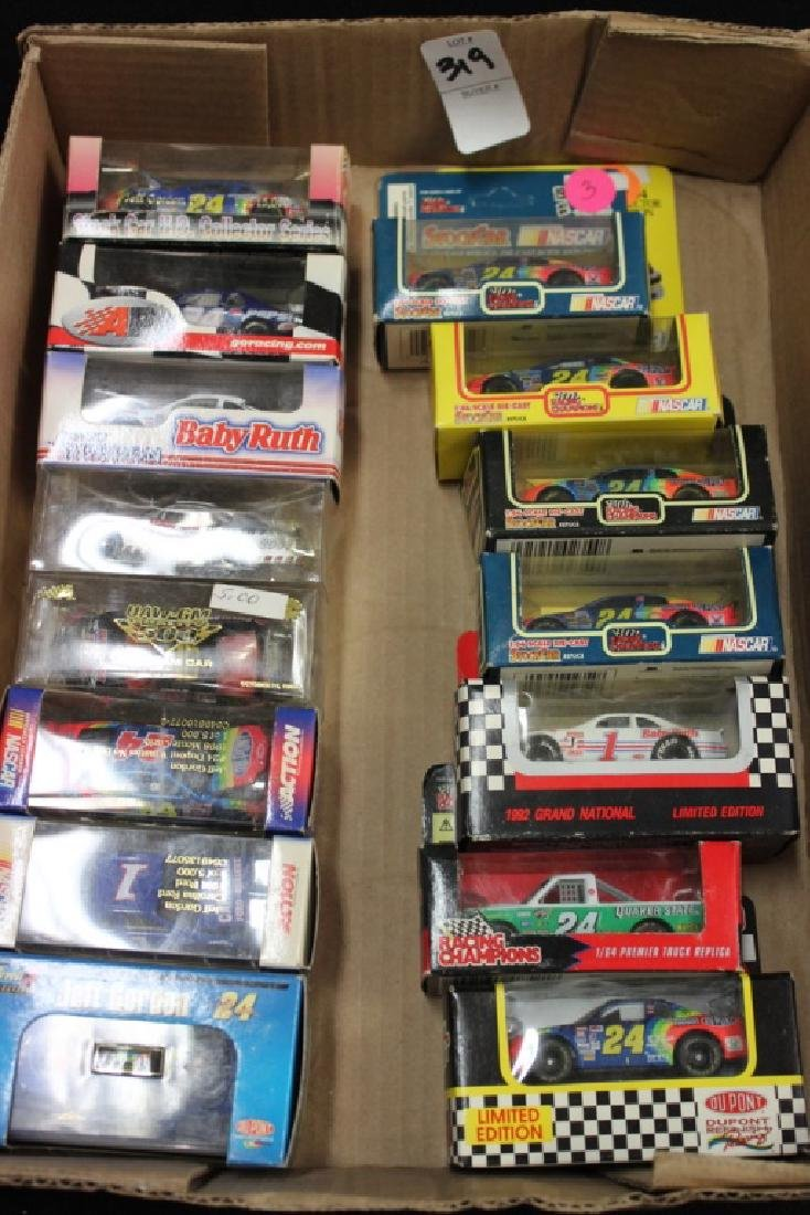 15 Nascar Cars in boxes