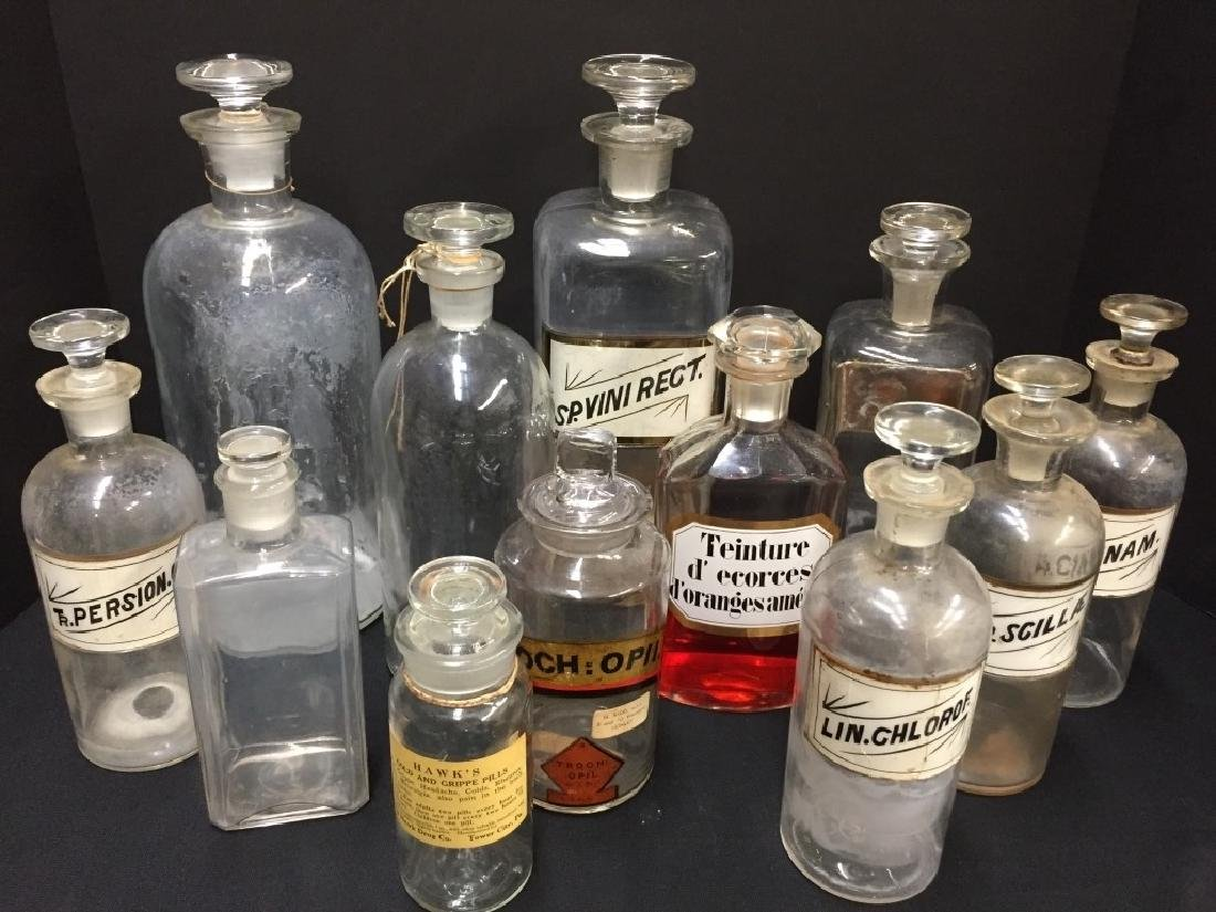 Large Grouping of Clear Bottles w/Stoppers