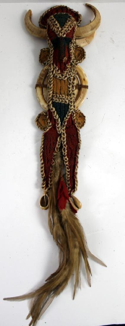 African Warrior Doll and Two Teeth of Animal