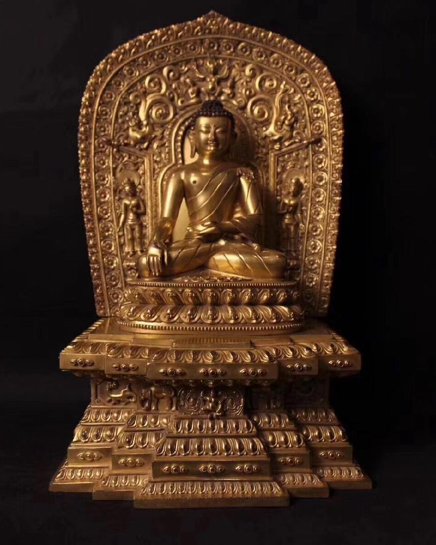 A MING GILT BRONZE FIGURE OF BUDDHA