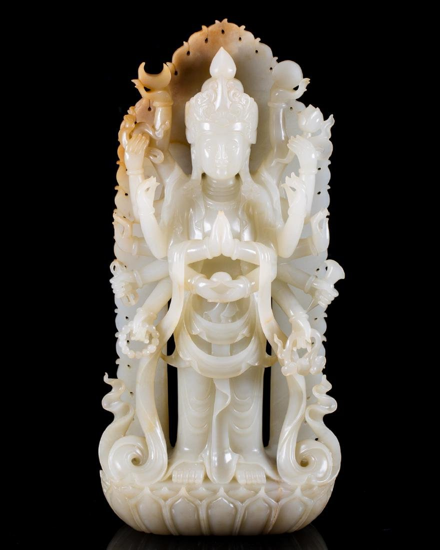 A HETIAN JADE CARVED GUANYIN FIGURE