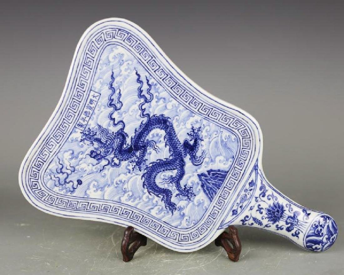A BLUE AND WHITE FAN WITH XUANDE MARK