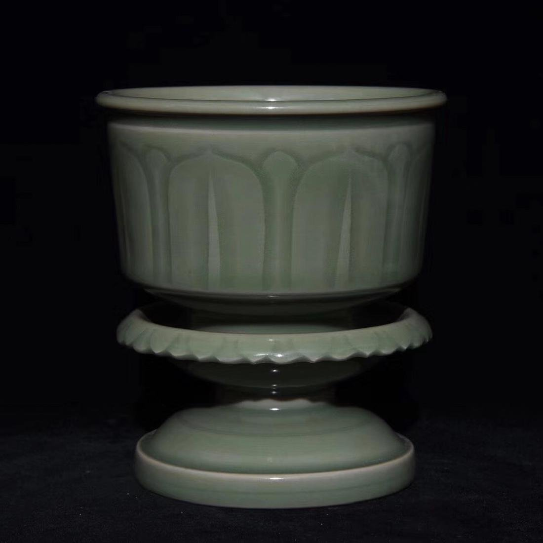A YUEYAO INCISED FLORAL DESIGN CUP