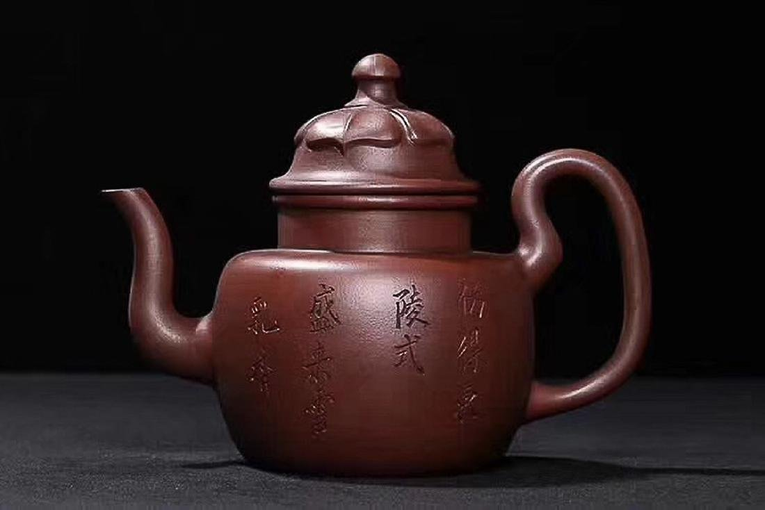 A HANLVTANG MARK SCRIBING OLD PURPLE CLAY TEAPOT, QING