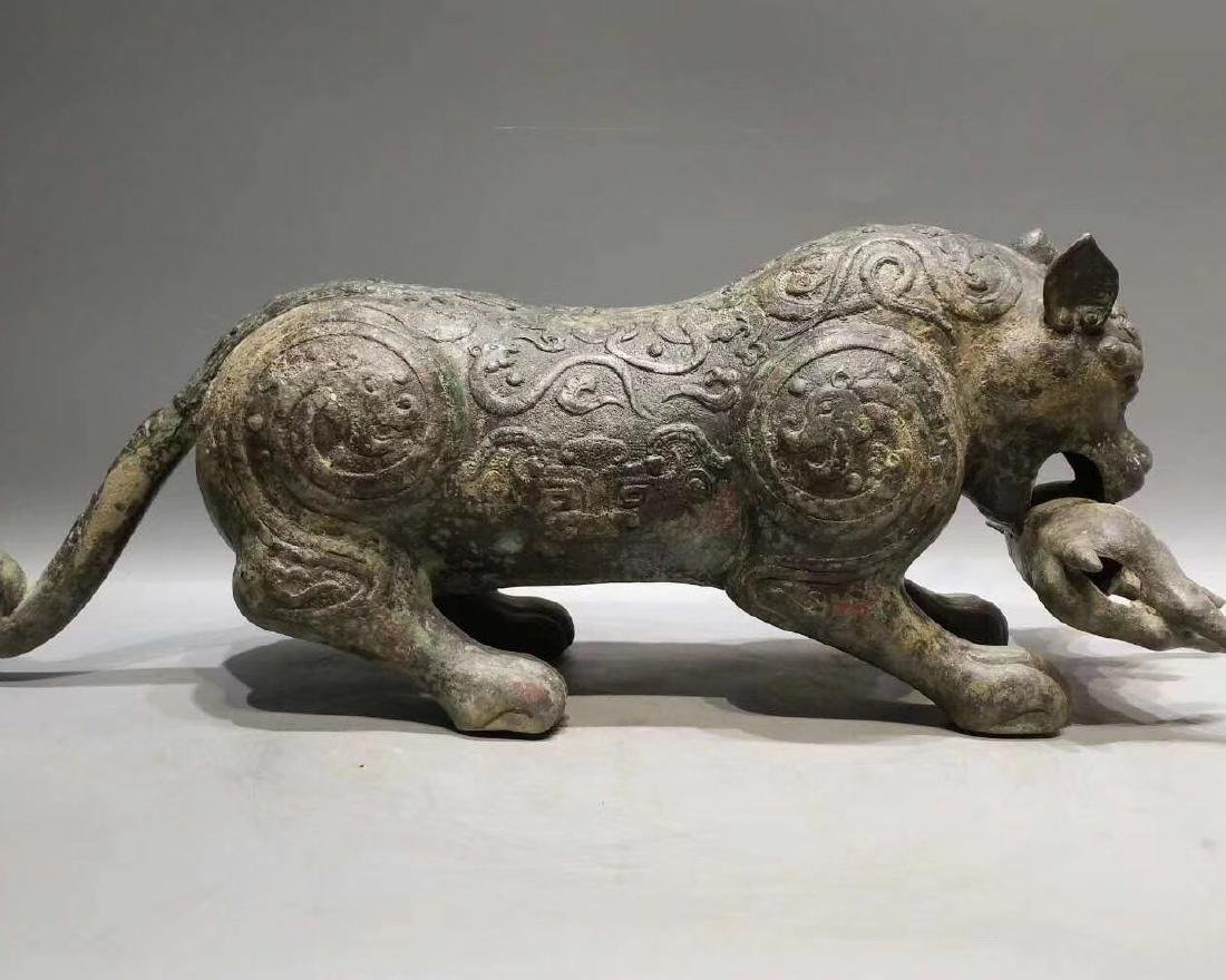 A BRONZE CARVED BEAST FIGURE