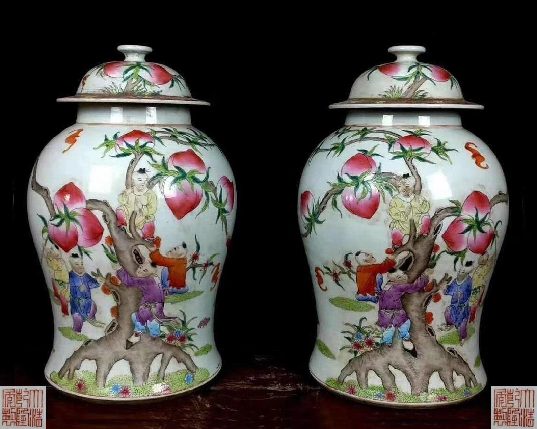PAIR OF FAMILLE-ROSE JARS WITH QIANLONG MARK