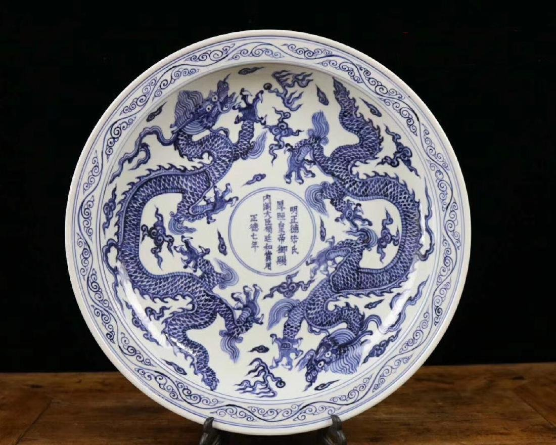 A BLUE AND WHITE DRAGON PATTERN CHARGER