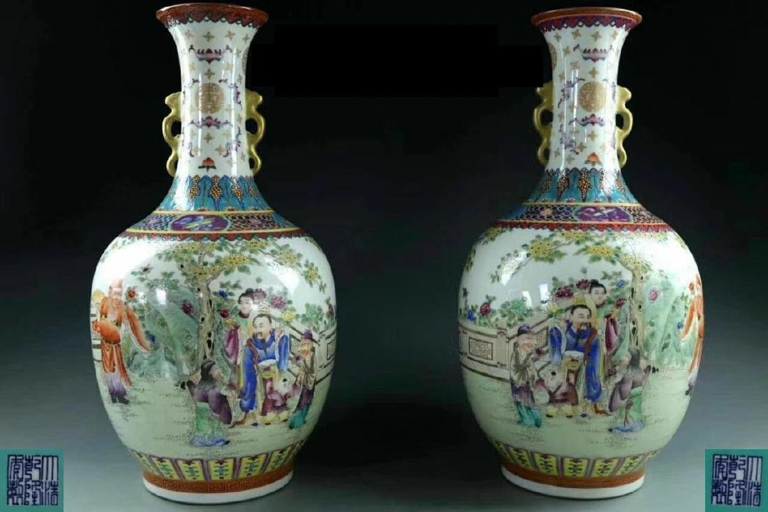 PAIR OF FAMILLE-ROSE VASES WITH QIANLONG MARK