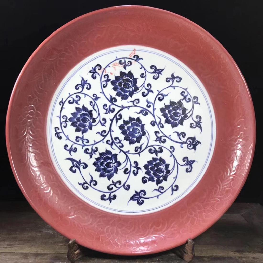 MING RED GLAZE LOTUS PATTERN CHARGER