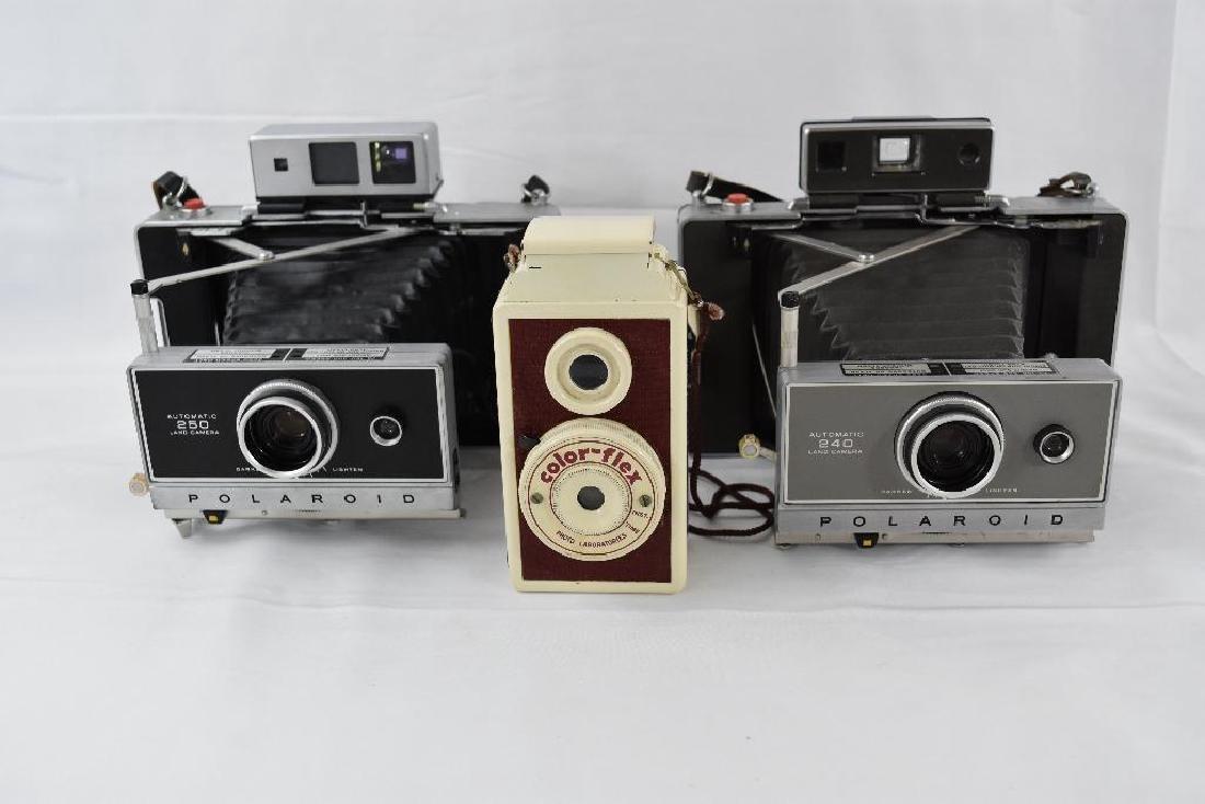 Three Vintage Cameras, One Colorflex, Two Polaroid.