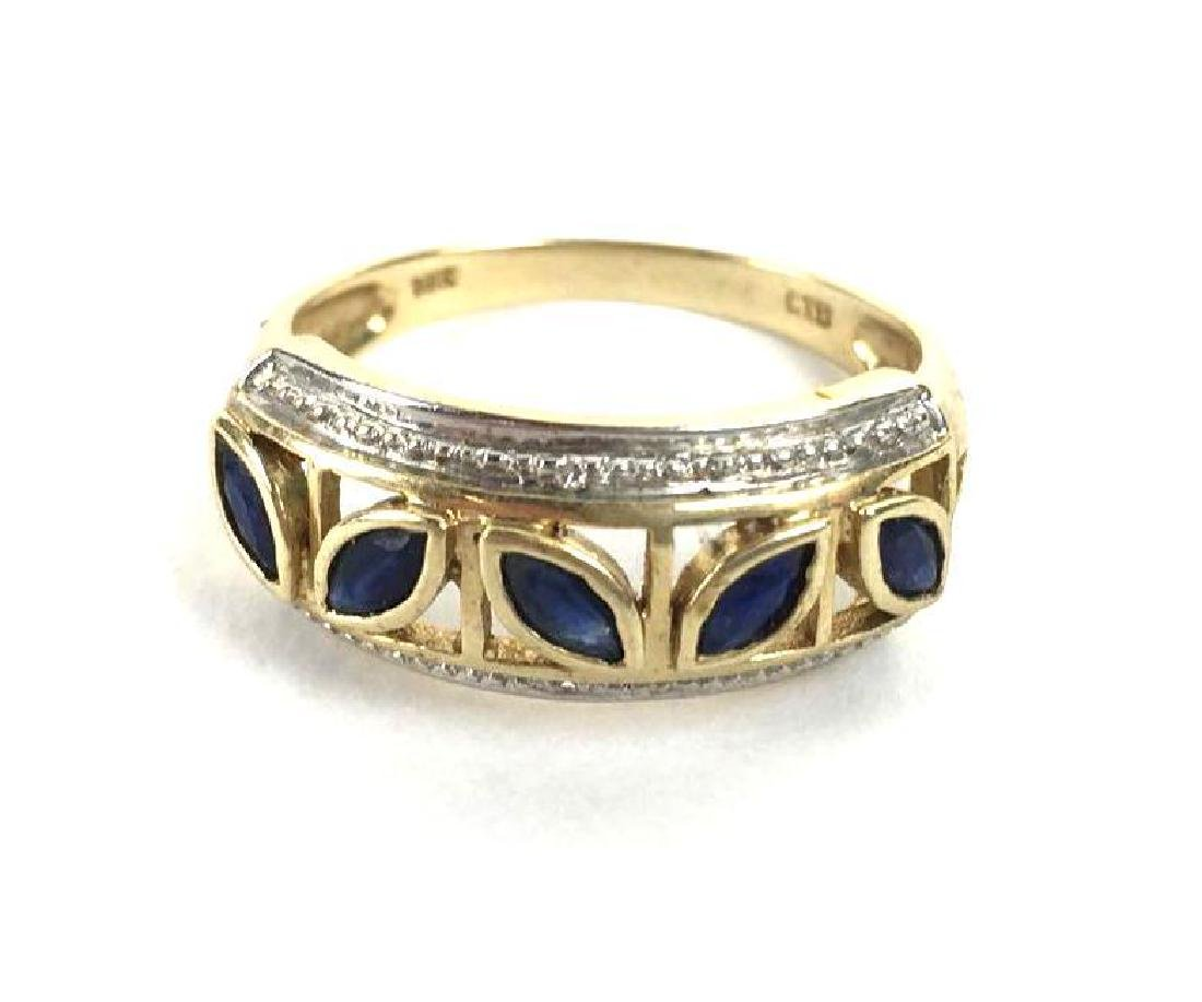 10k Gold Ring With Leaf Shaped Jewels