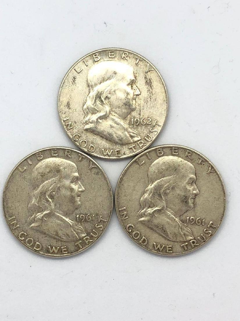 Three 1961 Franklin Half Dollars