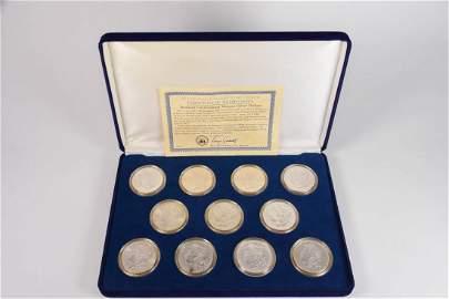 Eleven (11) Uncirculated Morgan Silver Dollars