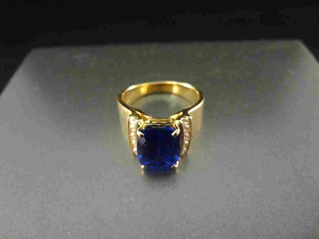 14k Gold Ring with Single Emerald Cut Dark Blue
