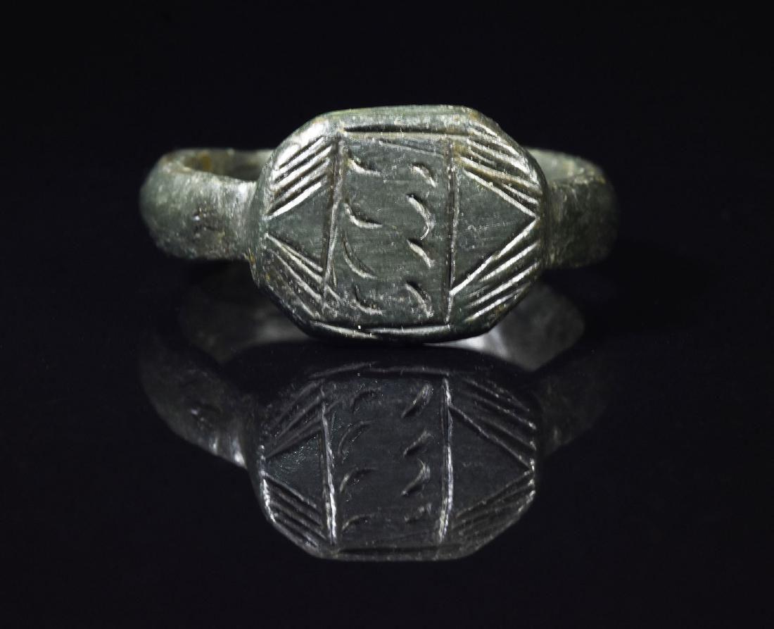 ROMAN LEGIONARY BRONZE RING WITH DECORATED BEZEL