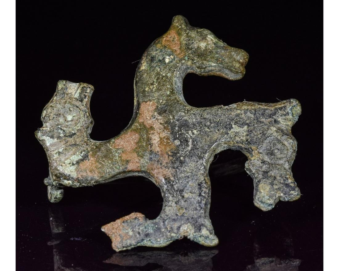 ROMAN BRONZE SWASTIKA BROOCH WITH HORSE HEADS