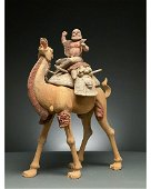 CHINA, TANG DYNASTY POTTERY BACTRIAN CAMEL AND RIDER -