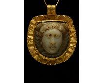ROMAN CAMEO STONE IN A GOLD PENDANT