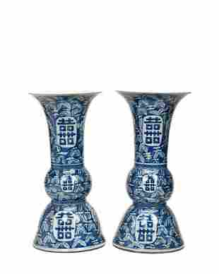 PAIR OF CHINESE BLUE AND WHITE VASES WITH SYMBOLS.