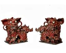 PAIR OF LARGE CHINESE IRON RED PORCELIAN DRAGONS