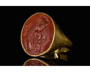 ROMAN GOLD INTAGLIO RING DEPICTING ZEUS AND EROS