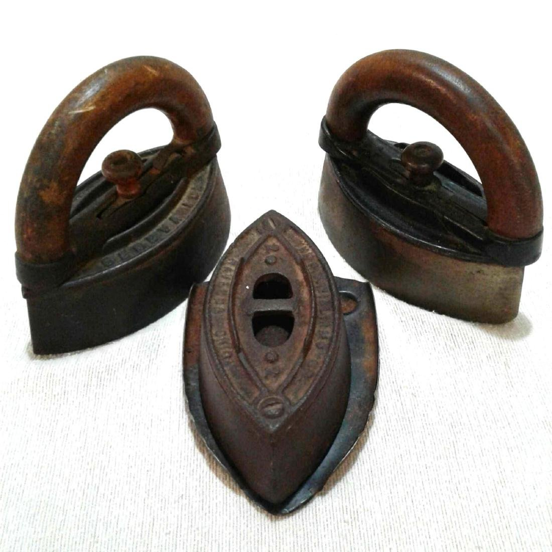 4 Antique Cast Iron Tailor Sad Irons
