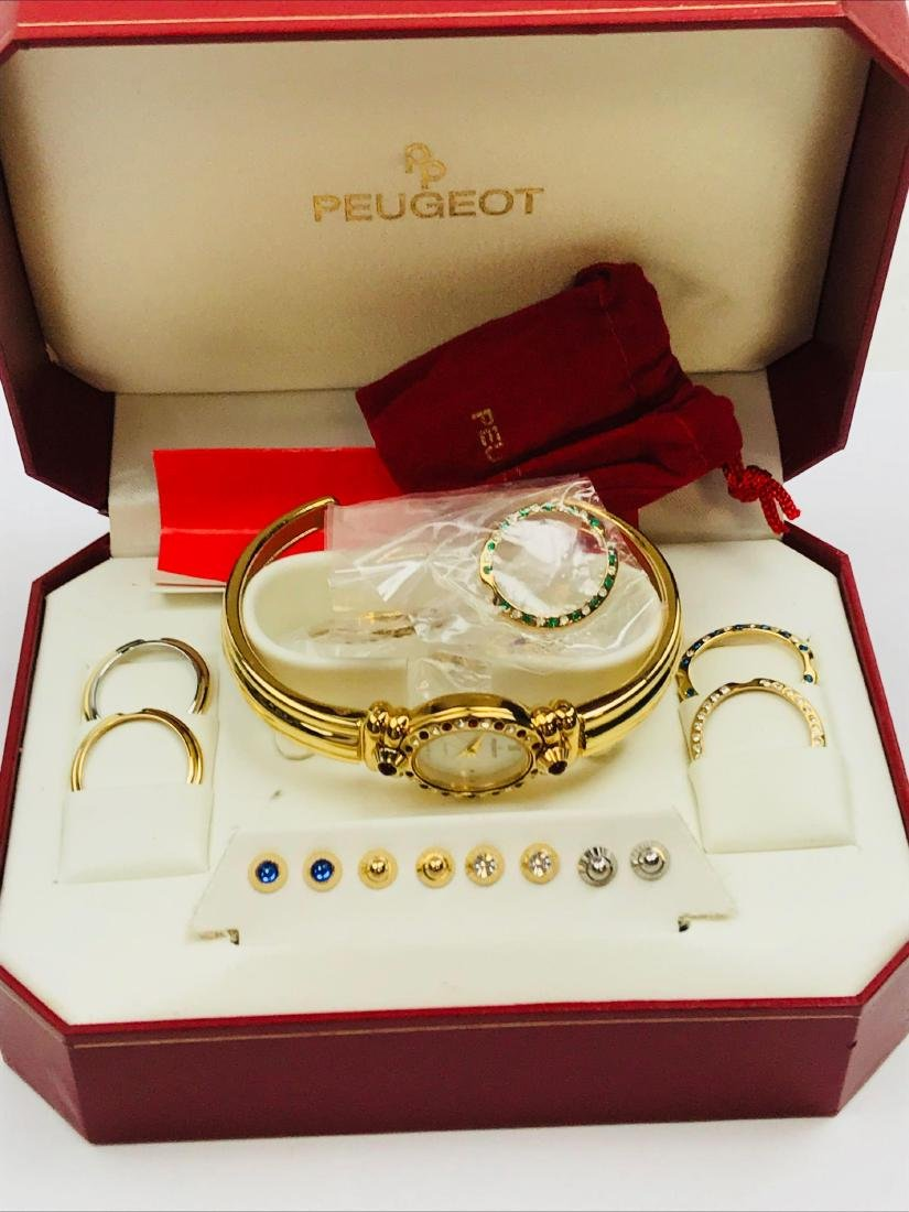 Ladies Peugeot Gold Watch with 7 Interchangeable Bezels
