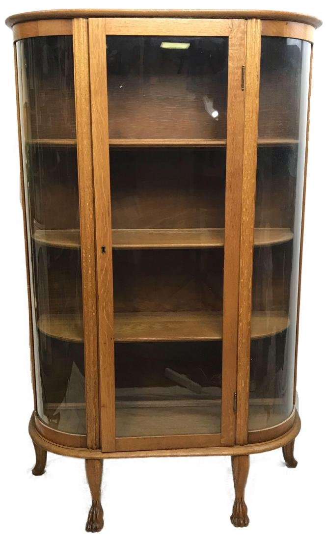 oak curved glass china cabinet paw feet antique curvy oct 18 rh liveauctioneers com antique curved glass china cabinet value
