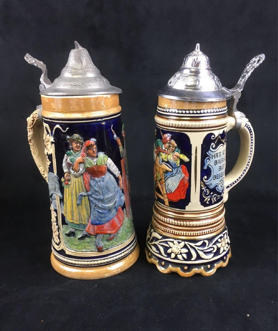 Two Vintage German Beer Steins with Pewter Lids
