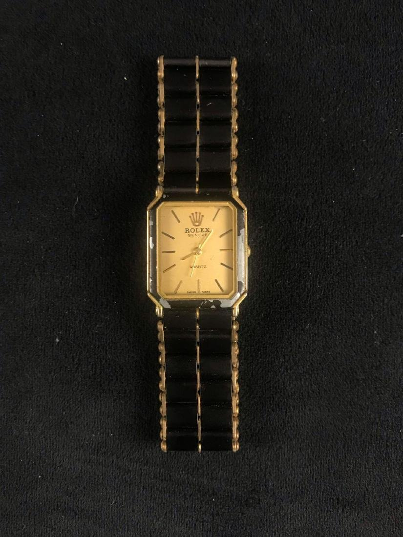 Vintage Rolex Geneve Quartz Gold Face Black Band