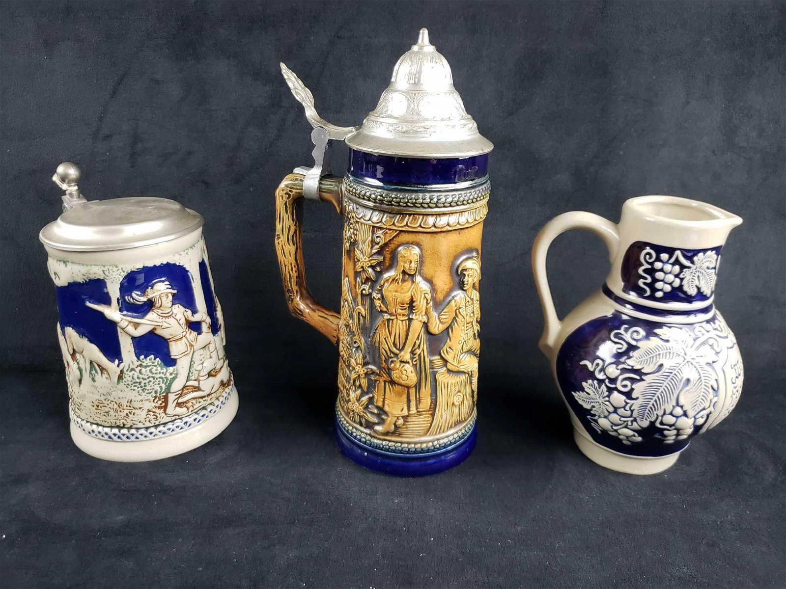 Set of 2 Lidded Beer Steins and 1 Pitcher