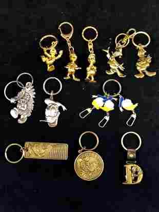 Lot of 11 Vintage Donald Duck Disney Park Metal Brass
