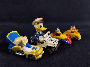 Lot of 4 Vintage Donald Duck Toy Cars