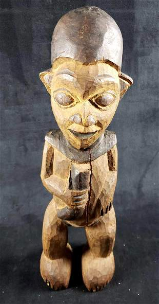 Hand Carved African Figure Holding Horn Statue