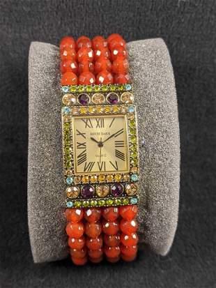 Red Beaded Heidi Daus Orange Bead Bracelet Watch.