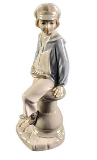 Retired Lladro Boy With Yacht Porcelain Figurine