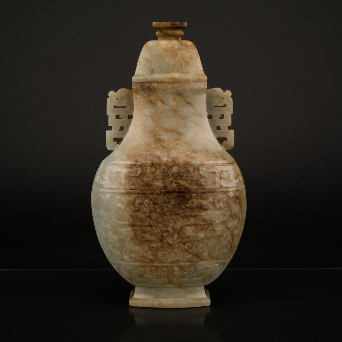 QING CARVED MUTTONFAT JADE OVAL VASE WITH MATCHING