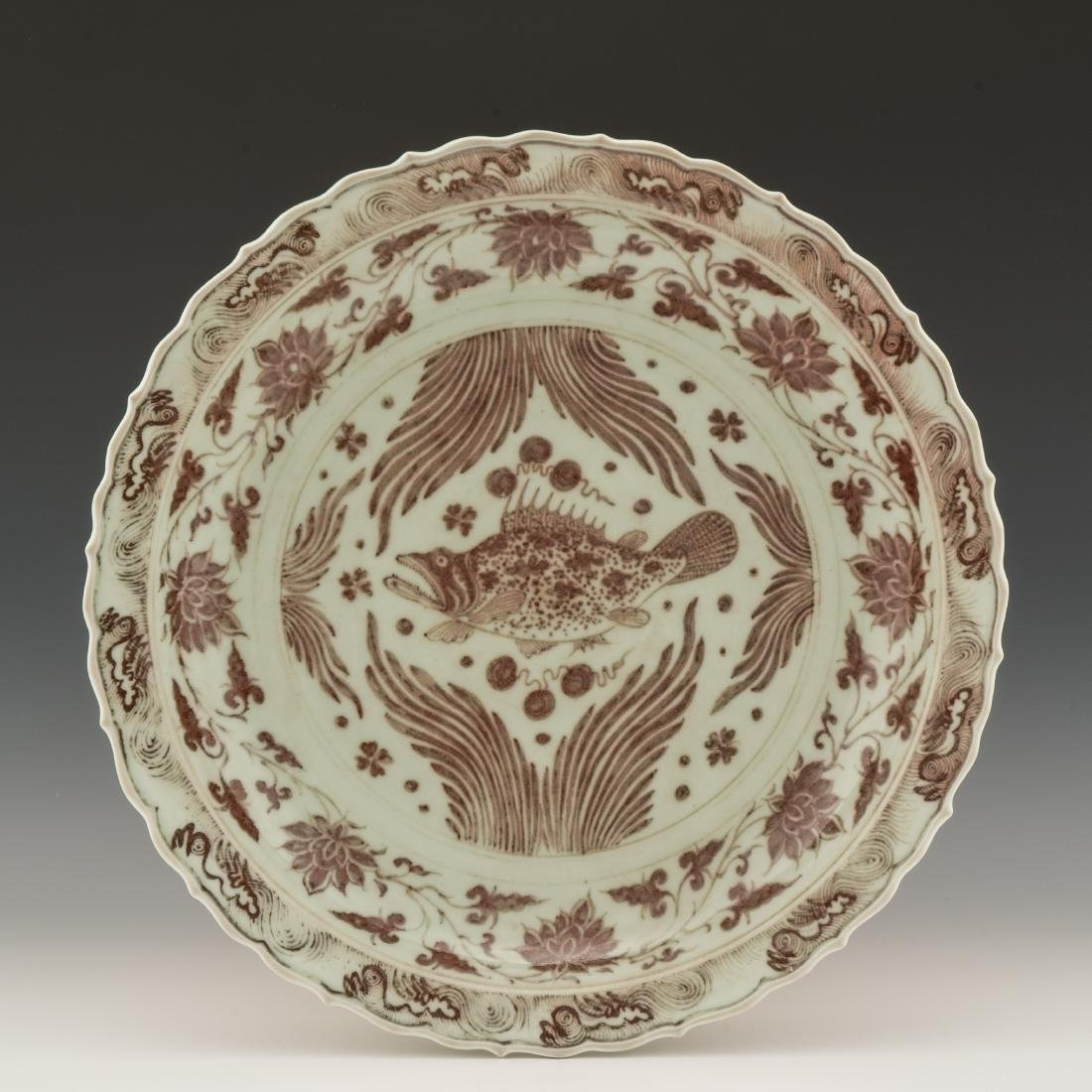 MING COPPER-RED UNDERGLAZED CHARGER WITH MANDARIN FISH