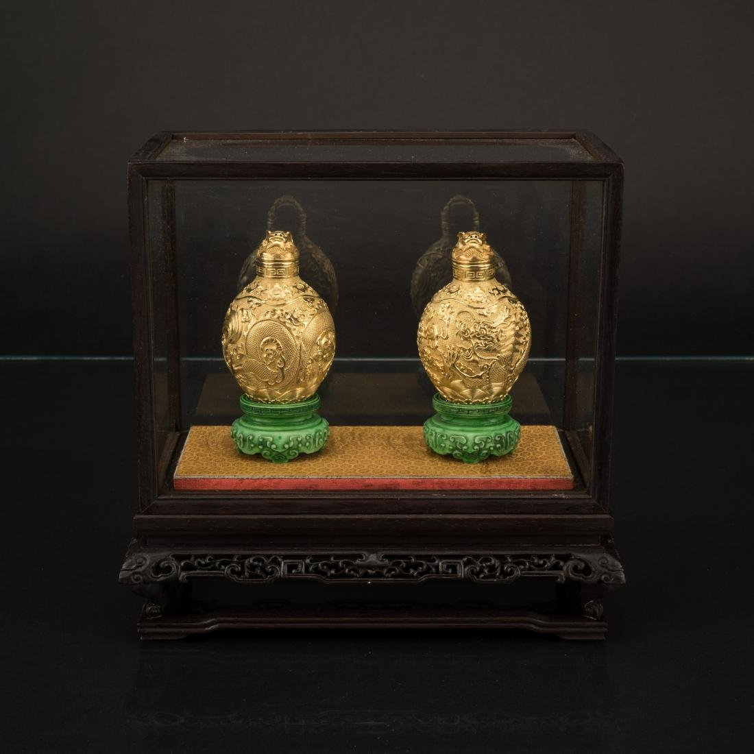 PAIR OF SOLID GOLD SNUFF BOTTLES WITH DISPLAY CASE