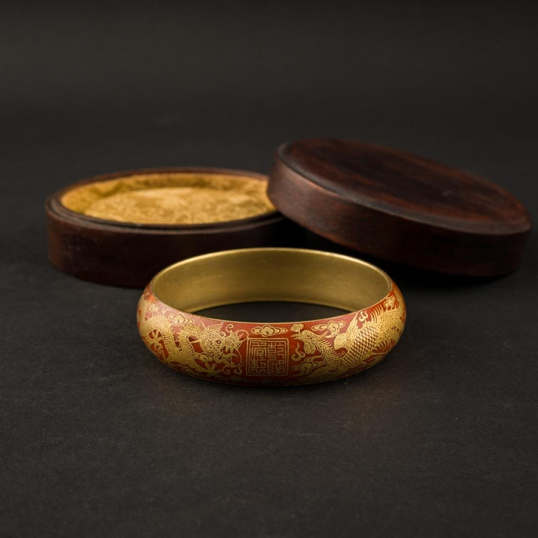 DRAGONS PHOENIX GILT OVER RED PORCELAIN BANGLE IN BOX