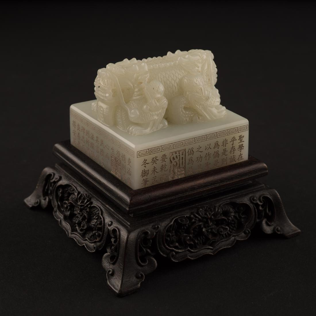 CHINESE WHITE JADE DRAGON SEAL ON STAND