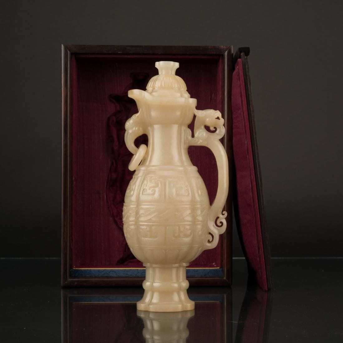 QING CARVED JADE EWER & FITTED BOX CELADON